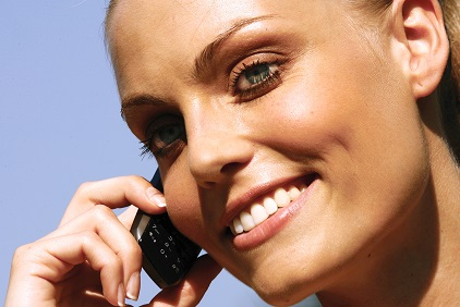 picture of a lady using a telephone